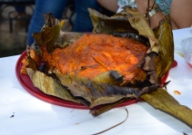 Pib! Like a large tamal, but the best one you'll ever taste. Cooked underground wrapped in banana leaves....